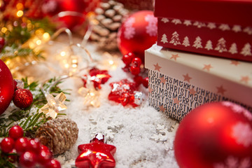 Christmas background. Red Christmas box on a red background. Greeting Christmas card.