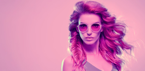 Fashion neon light. Girl with glowing Hairstyle