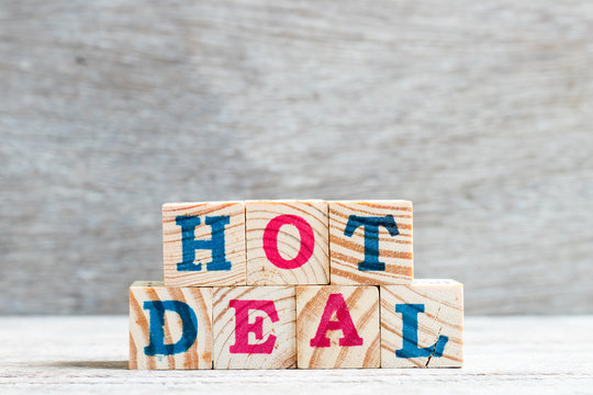 Letter block in word hot deal on wood background
