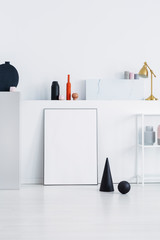 Black cone and ball on a white wall in a daily room interior
