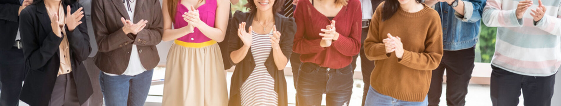 Business people clapping their hands, panoramic banner - congratulation and appreciation concepts.Group of business people giving an applause in the meeting, panoramic banner