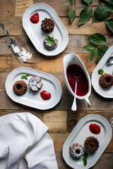 Mini bundt cake with raspberry sauce served on plates