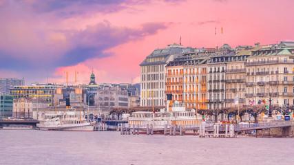 Fotomurales - Geneva skyline in Switzerland at twilight