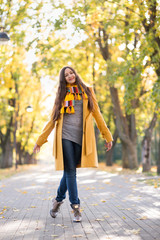 Young Woman walks in autumn park
