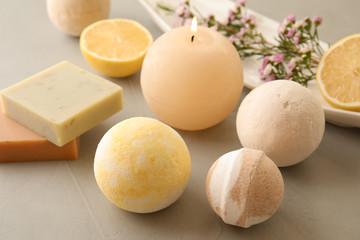 Wall Mural - Bath bombs, soap bars and scented candle on grey table