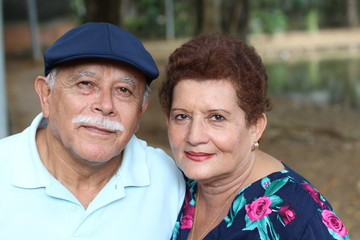 Hispanic senior couple with copy space