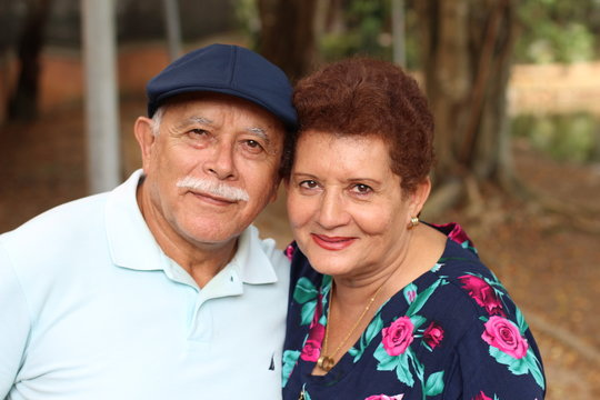 Tender older ethnic couple candid