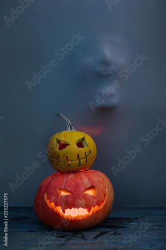 Illuminated pumpkin lanterns and mystic face