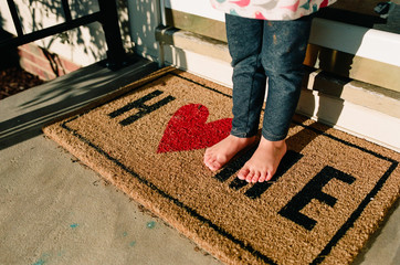little kid feet on welcome mat