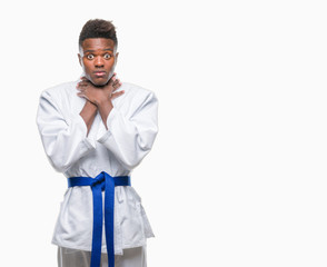 Young african american man over isolated background wearing kimono shouting and suffocate because painful strangle. Health problem. Asphyxiate and suicide concept.
