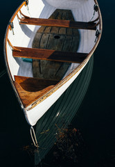 Wooden boat floating in the bay