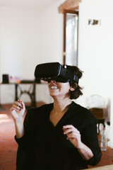 Woman using VR glasses for the first time
