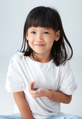 Asian child with a crystal in hand