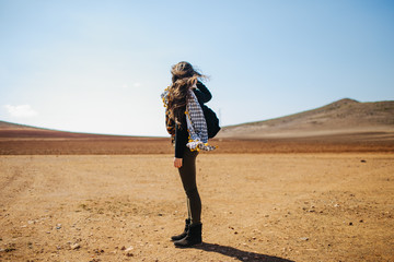 Girl looking to the horizon in the desert