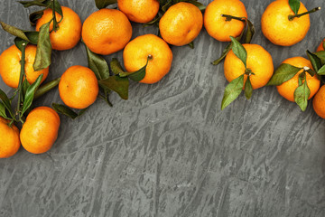 Tangerines on grey concrete background. Ripe tangerines. Top view and copy space.