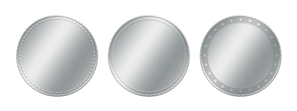 Three different silver coins over white