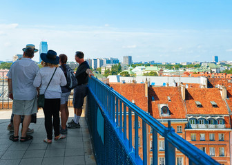 People looking at Royal Castle in Warsaw