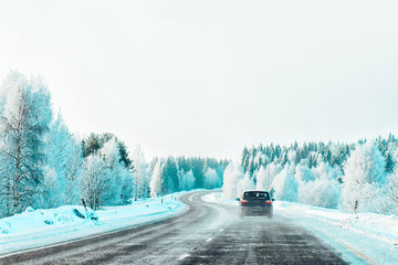 Car at winter road in Rovaniemi of Lapland in Finalnd