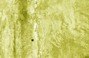Grungy cement wall texture in yellow tone.