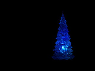 Christmas tree glowing in the black background
