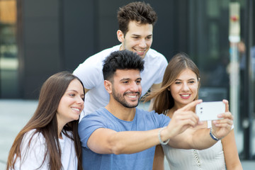 Group of friend taking a selfie picture together