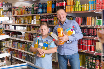 male and  son  choosing sweet beverages