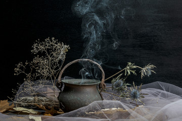 Magic pot with herbs and witchcraft