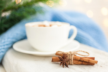 Cup of hot coffee with spices anise and cinnamon. Winter background