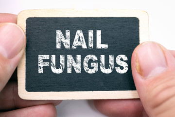 Nail fungus, text on blackboard. Fungal infection on nails hand, finger with onychomycosis, damage on human hand