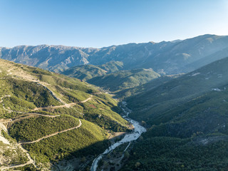 Aerial view of river in between mountains located in Borsh, Albania
