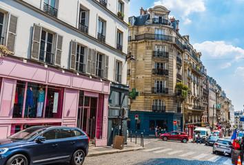 Elegant buildings and paved road in Montmartre in Paris