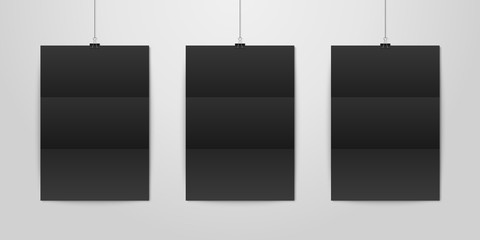 Three Vector Realistic Black Blank Vertical A4 Folded Paper Poster Hanging on a Rope with Binder Clip Set on White Wall mock-up. Empty Poster Design Template for Graphics, Mockup