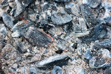 hot coals of the grill left after cooking meat on the grill