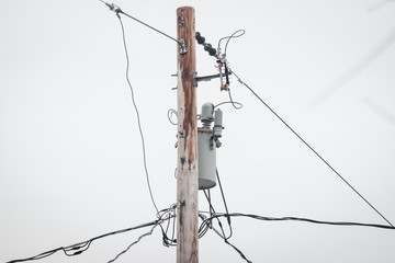 Power pole with wires and transformer