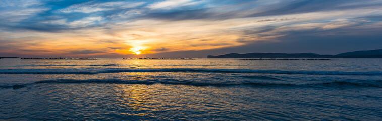 Panoramic view of Alghero shore at sunset