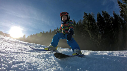 Little boy skiing.