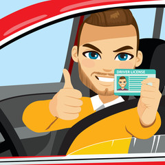 Attractive young man happy smiling showing his new driver license and making thumbs up hand sign gesture seated on car front seat