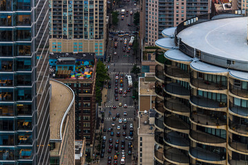 Aerial view looking down through the buildings on the crowded city streets of Chicago Illinois from above