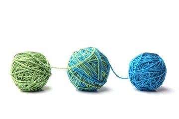 Colorful cotton thread ball from two color green and blue thread isolated on white background. Different color green and blue thread mix.