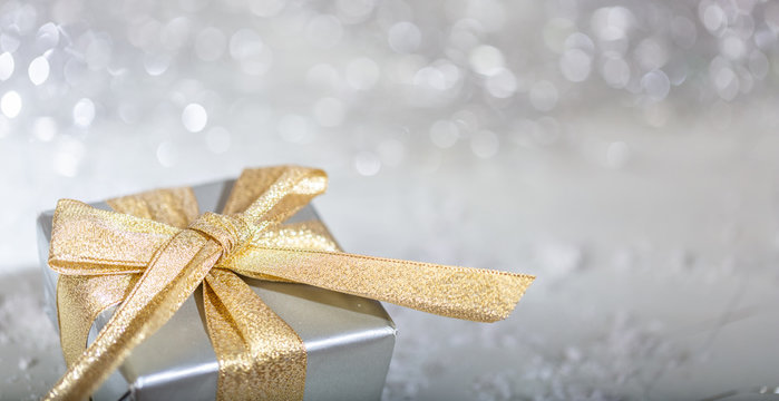 Christmas gift box on abstract bokeh lights and glitter background