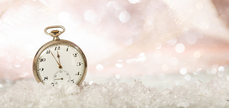 New Years eve. Minutes to midnight on an old fashioned pocket watch