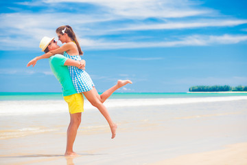 happy young couple in bright clothes having fun by the beach. Khao Lak, Thailand