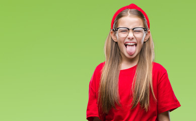Young beautiful girl wearing glasses over isolated background sticking tongue out happy with funny expression. Emotion concept.