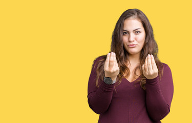 Beautiful and attractive plus size young woman wearing a dress over isolated background Doing money gesture with hand, asking for salary payment, millionaire business