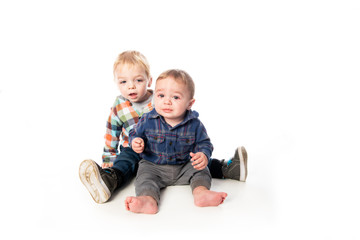 Two Cute Little child Boy Isolated on the White Background.