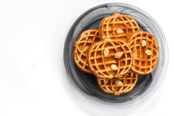 Homemade Pumpkin shaped waffles on white background