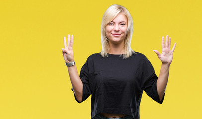 Young beautiful blonde woman over isolated background showing and pointing up with fingers number eight while smiling confident and happy.