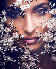 beauty young woman throw white lace close up, bride under veil
