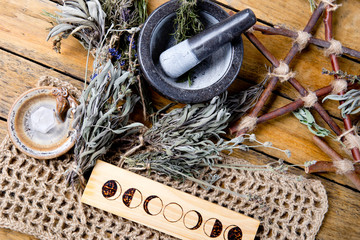 Herbal Witch mortar and pestle with moon phases, branch pentagram and dried herb bundles