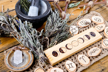 Moon Phases and astrological symbols with herb witch mortar and pestle
